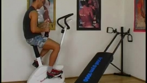 Blonde Working Out At The Gym With Expert Trainers
