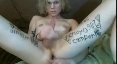 Tattooed Blonde Sucking On A World Record Cock