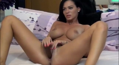 Gorgeous Brunette With Big Tits, Kylie Page Is Masturbating With A Sex Toy, In Front Of The Camera