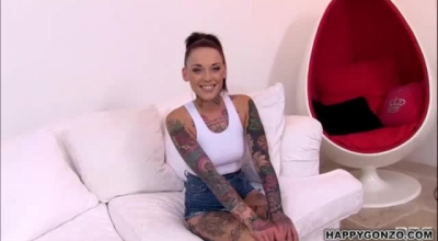 Stunning Tattooed Brunette Posing On Top Of His Hard Cock