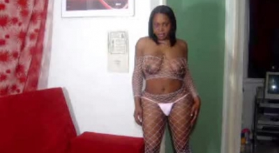 Spunky Black Tranny Uses One Of Her Massive, Red Meat Poles To Give A Footjob And Take A Big Cock