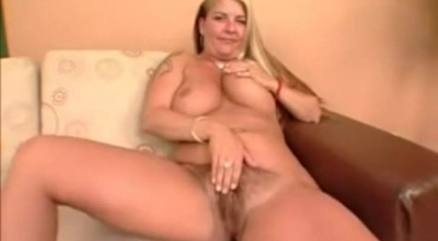 Blonde With Big Tits Spreades Hairy Pussy In The Bathroom